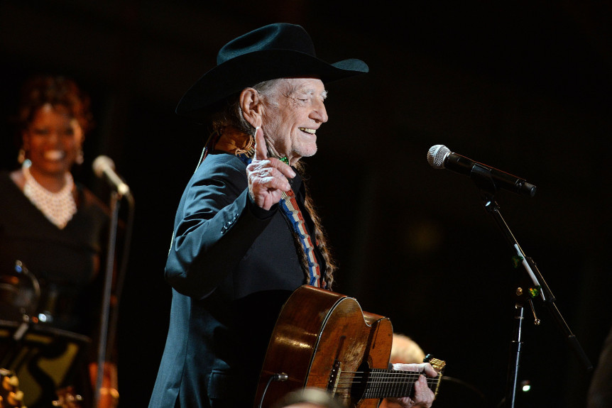 "WASHINGTON, DC - NOVEMBER 06: (AFP OUT) Singer Willie Nelson performs at ""A Salute to the Troops: In Performance at the White House"" on the South Lawn November 6, 2014 in Washington, DC. The President and First Lady invited music legends, members of the U.S. military, military veterans, and their families to the White House for a celebration of the men and women who serve the United States. (Photo by Olivier Douliery-Pool/Getty Images)"